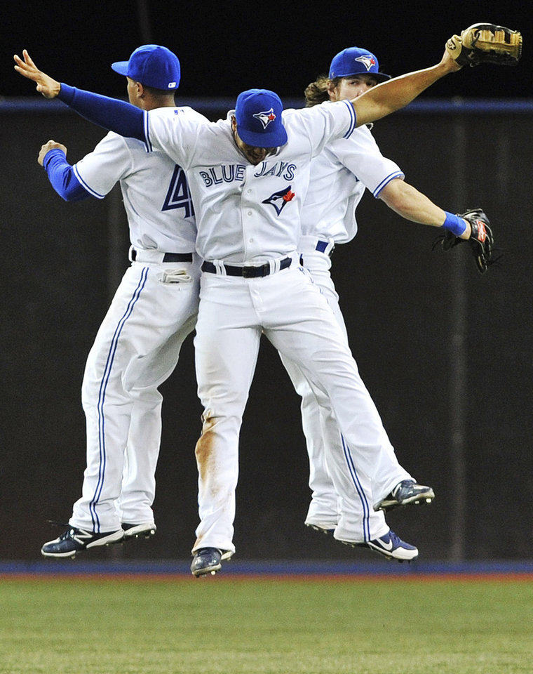 Photo -   From left, Toronto Blue Jays' Anthony Gose, Moises Sierra, and Colby Rasmus celebrate their 6-0 win against the New York Yankees in a baseball game in Toronto, Thursday, Sept. 27, 2012. (AP Photo/The Canadian Press, Aaron Vincent Elkaim)