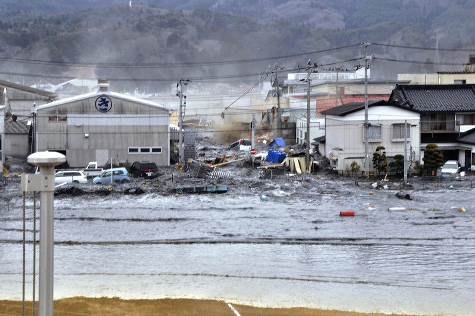 Photo - A tsunami tidal wave washes away houses in Kesennuma, Miyagi Prefecture, Friday, March 11, 2011 after strong earthquakes hit the area. (AP Photo/Keichi Nakane, The Yomiuri Shimbun) JAPAN OUT, CREDIT MANDATORY ORG XMIT: TOK839