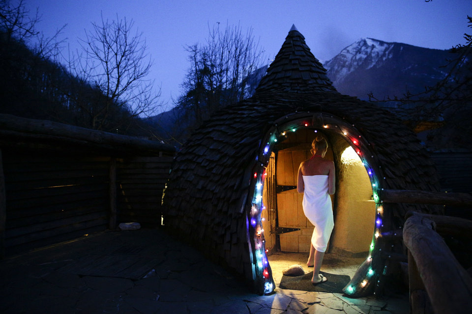 Photo - Olga Gharkova enters a aromatherapy room at the British Banya bathhouse, Saturday, Feb. 15, 2014, in Krasnaya Polyana, Russia, just a few miles away from the ski slopes where athletes are competing for Olympic medals. (AP Photo/Jae C. Hong)