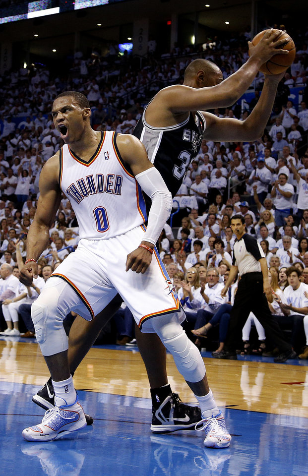 Photo - Oklahoma City's Russell Westbrook (0) celebrates a dunk in front of San Antonio's Boris Diaw (33) during Game 6 of the Western Conference Finals in the NBA playoffs between the Oklahoma City Thunder and the San Antonio Spurs at Chesapeake Energy Arena in Oklahoma City, Saturday, May 31, 2014. Photo by Bryan Terry, The Oklahoman