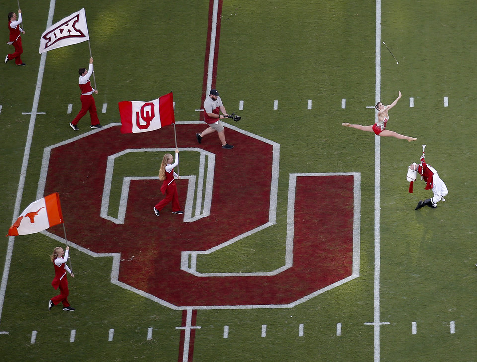 Photo - The Pride of Oklahoma marching band performs before a college football game between the University of Oklahoma Sooners (OU) and the Houston Cougars at Gaylord Family-Oklahoma Memorial Stadium in Norman, Okla., Sunday, Sept. 1, 2019. [Sarah Phipps/The Oklahoman]
