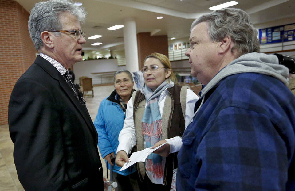 Photo - U.S. Senator Tom Coburn speaks to Alejandrina Rojo Rios, Alexandra Delgadillo and Mike Priest, from right, during Coburn's town hall meeting Wednesday at the Metro Tech Springlake campus in Oklahoma City.  Photo by Chris Landsberger, The Oklahoman  CHRIS LANDSBERGER