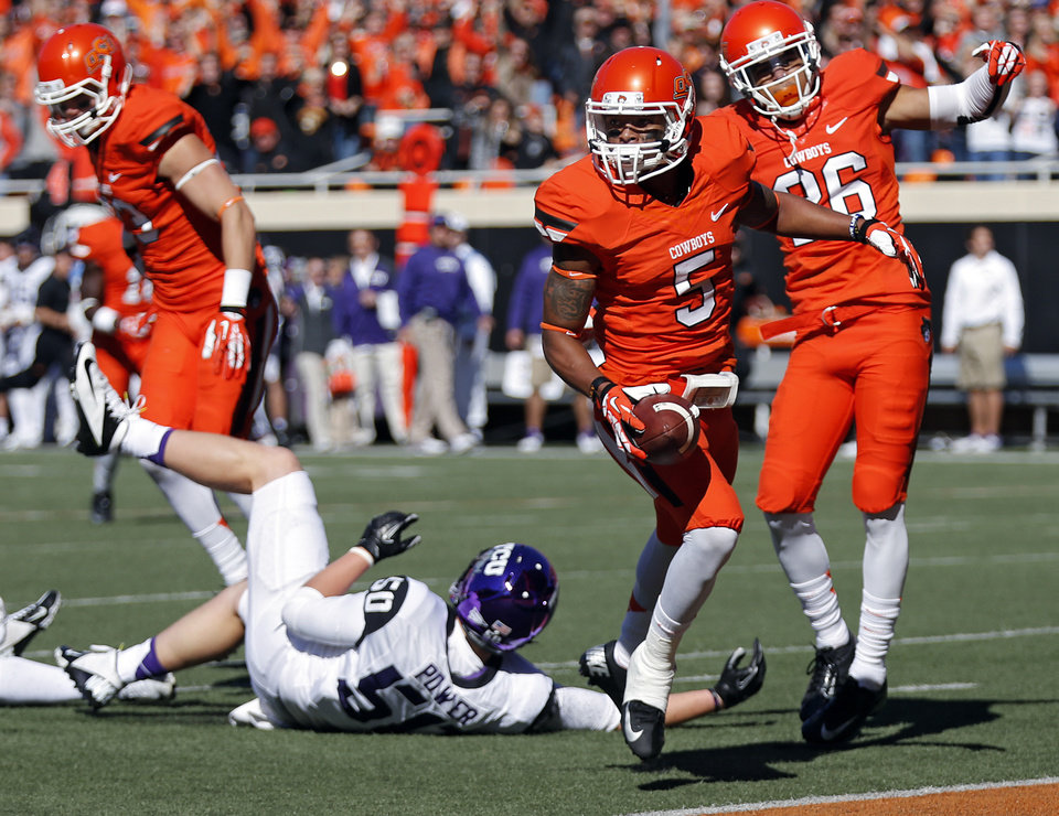 Photo - Oklahoma State's Josh Stewart (5) runs past TCU's James Power (50) for a kick return touchdown during a college football game between the Oklahoma State University Cowboys (OSU) and the Texas Christian University Horned Frogs (TCU) at Boone Pickens Stadium in Stillwater, Okla., Saturday, Oct. 19, 2013. Photo by Chris Landsberger, The Oklahoman