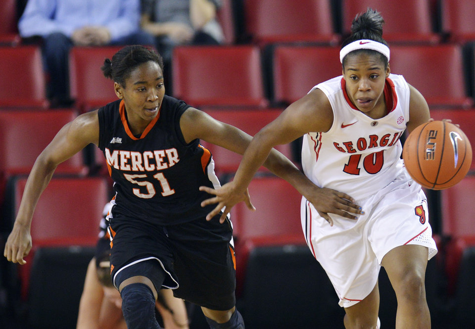 Mercer guard Tabitha Bradshaw (51) pressures Georgia guard Jasmine James (10) during the second half of an NCAA college basketball game, Tuesday, Dec. 4, 2012, in Athens, Ga. Georgia won 80-38. (AP Photo/Richard Hamm)