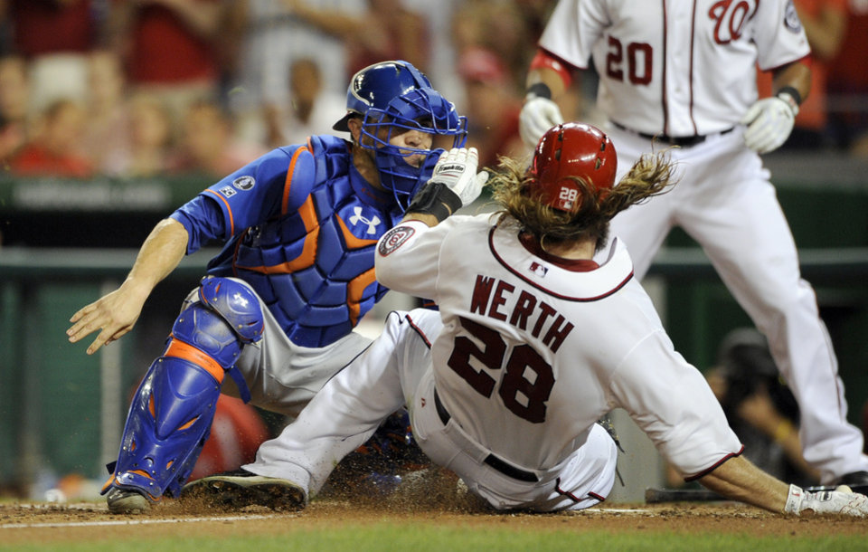 Photo - Washington Nationals' Jayson Werth (28) is tagged out at the plate by New York Mets catcher Travis d'Arnaud, left, during the sixth inning of a baseball game, Tuesday, Aug. 5, 2014, in Washington. (AP Photo/Nick Wass)