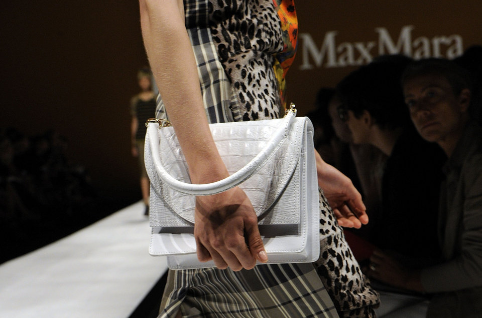 Photo -   A model wears a creation part of the Max Mara Women's Spring-Summer 2013 fashion collection, during the fashion week in Milan, Italy, Thursday, Sept. 20, 2012. (AP Photo/Giuseppe Aresu)
