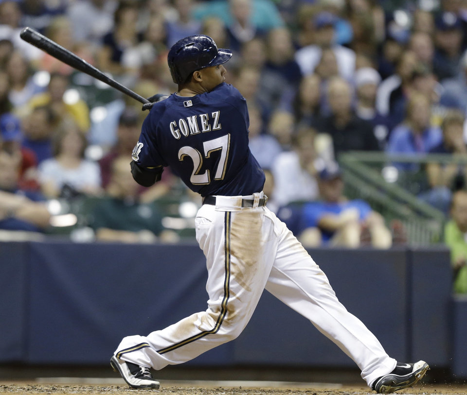 Photo -   Milwaukee Brewers' Carlos Gomez watches his RBI double against the Pittsburgh Pirates during the seventh inning of a baseball game Saturday, Sept. 1, 2012, in Milwaukee. (AP Photo/Jeffrey Phelps)