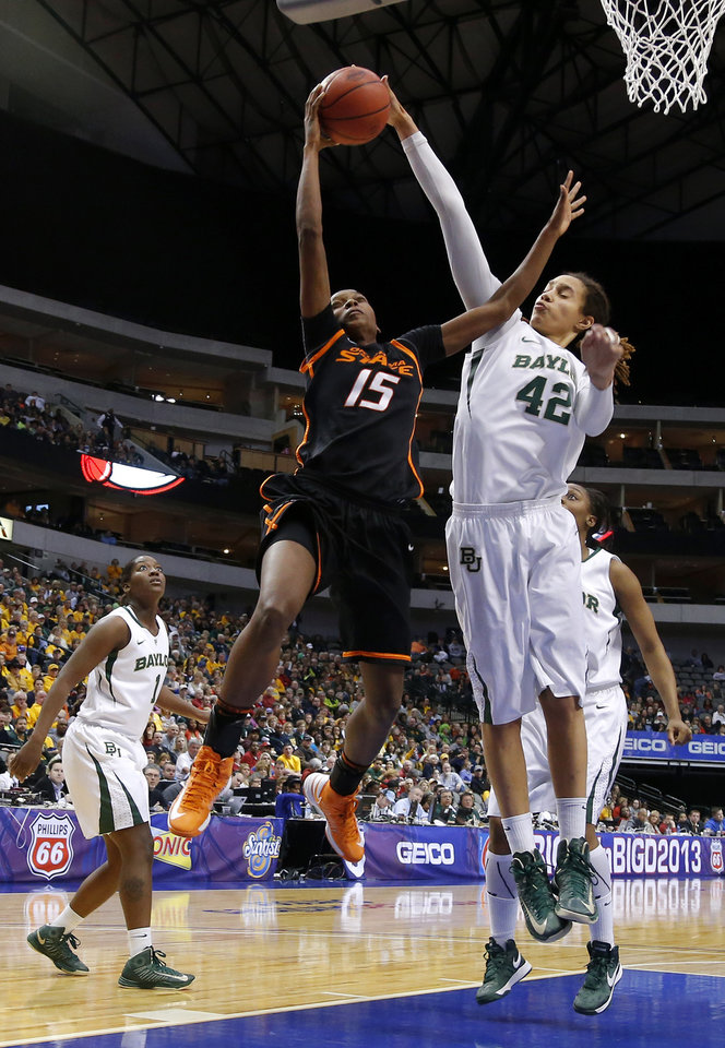 Photo - Oklahoma State's Toni Young (15) is blocked by Baylor's Brittney Griner (42) during the Big 12 tournament women's college basketball game between Oklahoma State University and Baylor at American Airlines Arena in Dallas, Sunday, March 10, 2012.  Oklahoma State lost 77-69. Photo by Bryan Terry, The Oklahoman