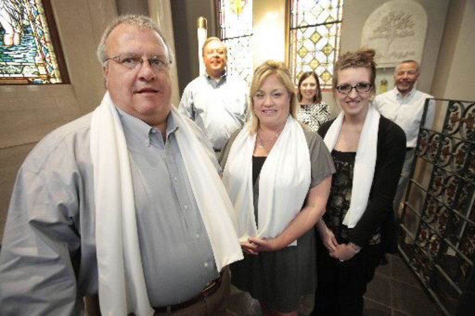 Brannon Smith, Kristin Smith and Alyssa Cozby wear the stoles that will be draped around them after they are baptized at the Easter Vigil set for Saturday at Our Lady�s Cathedral, 3214 N Lake Ave. In back are their sponsors Kurt Rupert, Marcia Rupert and Andy Monteiro. Photo By David McDaniel, The Oklahoman
