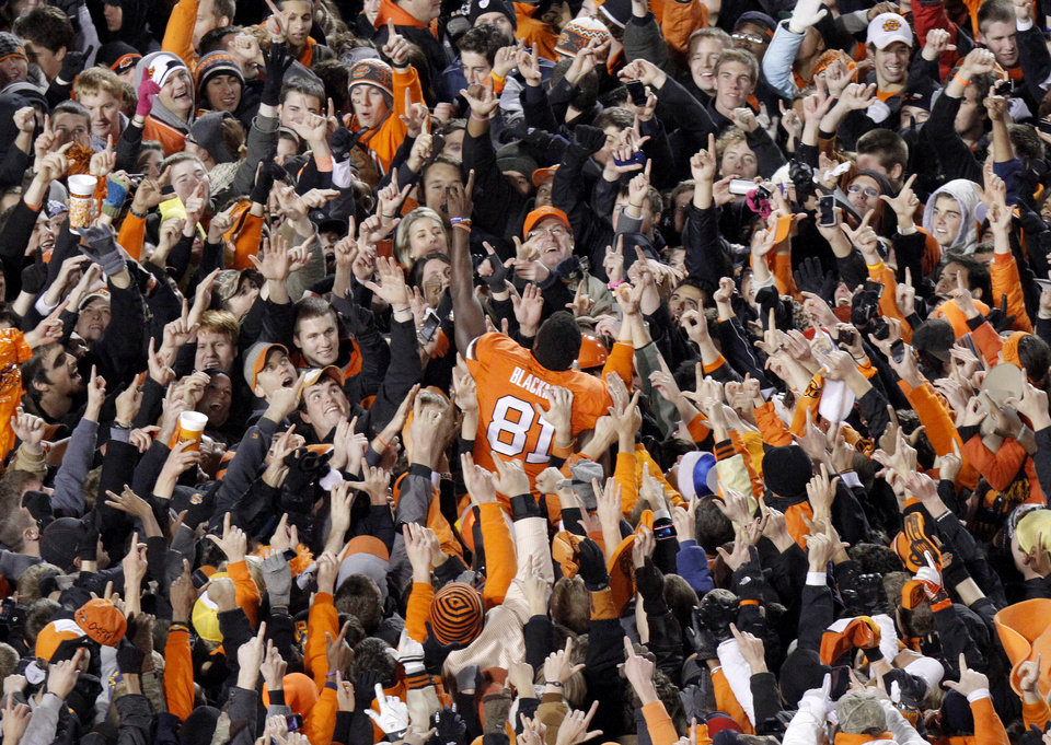 Photo - Oklahoma State's Justin Blackmon (81) celebrates with the crowd following the Bedlam college football game between the Oklahoma State University Cowboys (OSU) and the University of Oklahoma Sooners (OU) at Boone Pickens Stadium in Stillwater, Okla., Saturday, Dec. 3, 2011. Photo by Bryan Terry, The Oklahoman