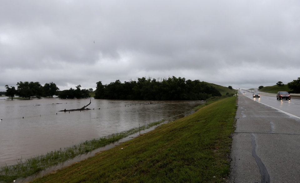 Photo - Flooding next to i-40 near the Medicine Creek exit is pictured, Sunday, May 24, 2015. Photo by Sarah Phipps, The Oklahoman