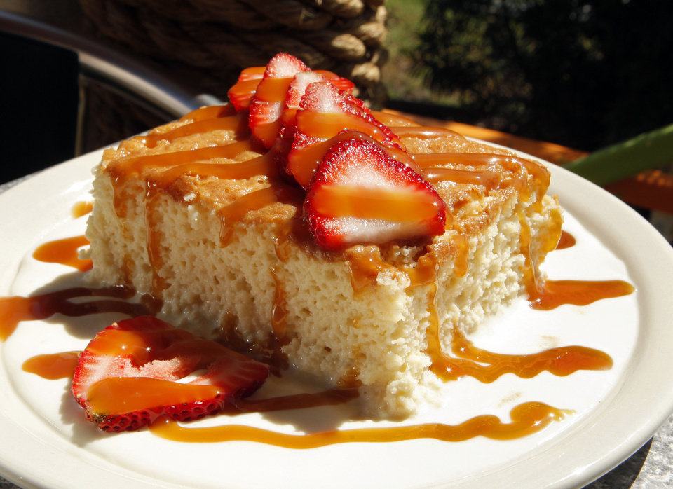 Photo - Tres Leches cake is served at the  Chuy's Mexican restaurant in Norman.  STEVE SISNEY - THE OKLAHOMAN