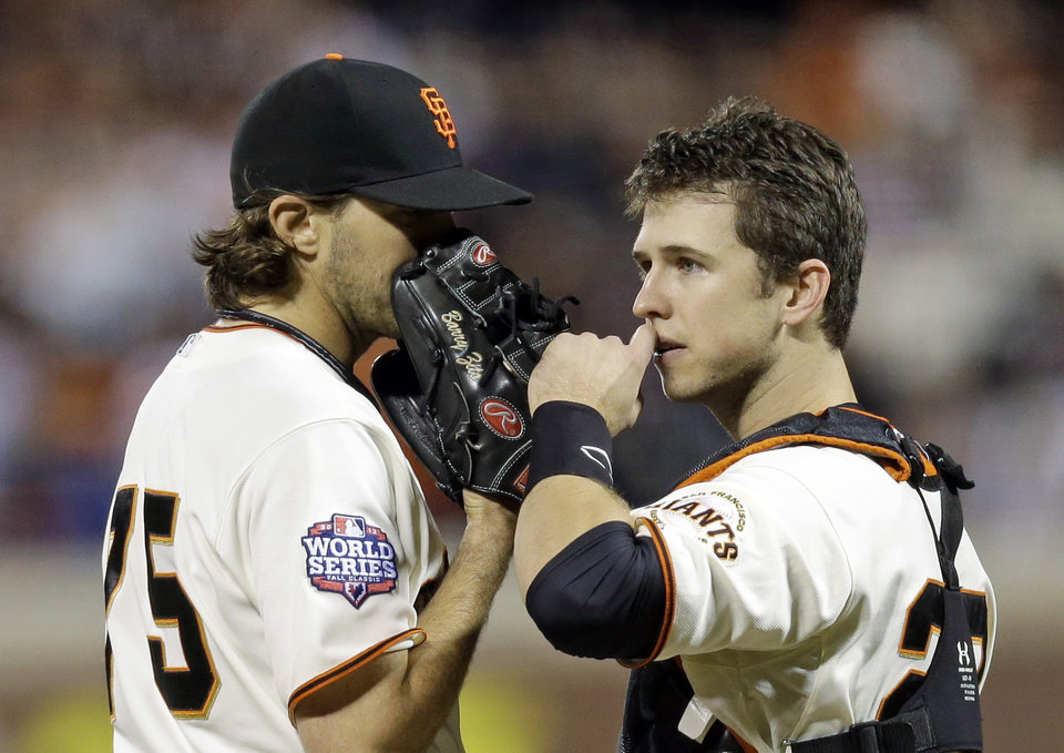 Photo -   San Francisco Giants' Barry Zito, left, talks to catcher Buster Posey during the sixth inning of Game 1 of baseball's World Series against the Detroit Tigers Wednesday, Oct. 24, 2012, in San Francisco. (AP Photo/Marcio Jose Sanchez)