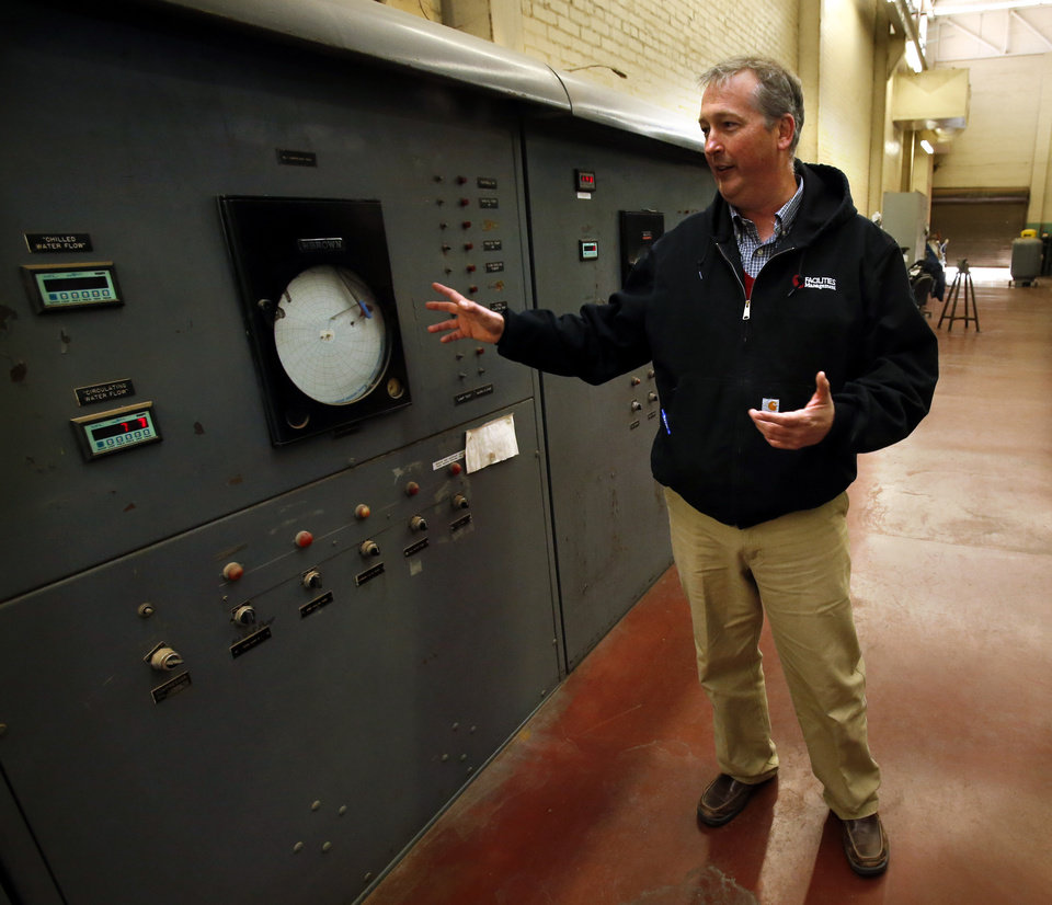 University of Oklahoma facilities manager Brian Ellis shows an analog recorder inside the old powere/heat/air plant on campus as he discusses energy saving enhancements to the Norman campus on Tuesday, Nov. 27, 2012 in Norman, Okla.  Photo by Steve Sisney
