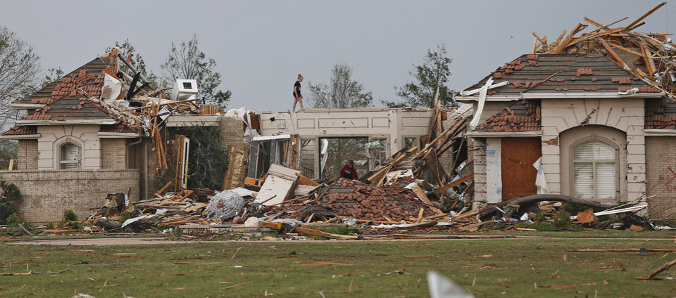 Residents survey the damage after the tornado hit the area near 149th and Drexel on Monday, May 20, 2013 in Oklahoma City, Okla.  Photo by Chris Landsberger, The Oklahoman