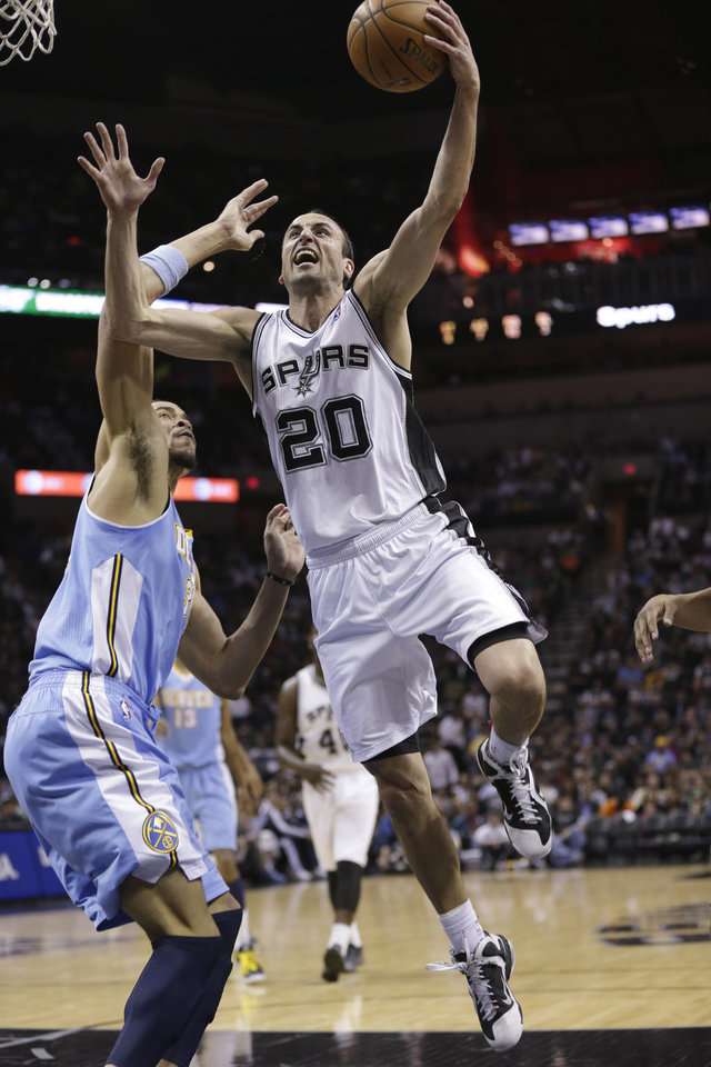 Photo - San Antonio Spurs' Manu Ginobili (20), of Argentina, drives to the basket past Denver Nuggets' JaVale McGee, left, during the first half of an NBA basketball game, Wednesday, March 27, 2013, in San Antonio. (AP Photo/Eric Gay)