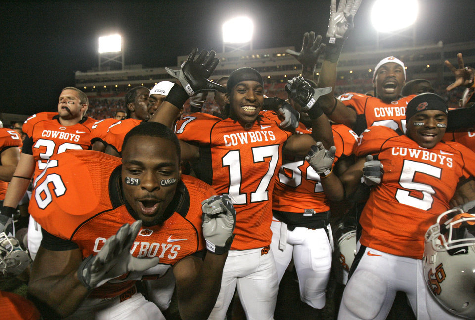 Photo - CELEBRATION: Oklahoma State celebrate after 56-28 win over Texas A&M in the college football game between the Oklahoma State University Cowboys (OSU) and the Texas A&M University Aggies (TAM) at Boone Pickens Stadium on Saturday, Oct. 4,  2008, in Stillwater, Okla. SARAH PHIPPS, THE OKLAHOMAN  ORG XMIT: KOD