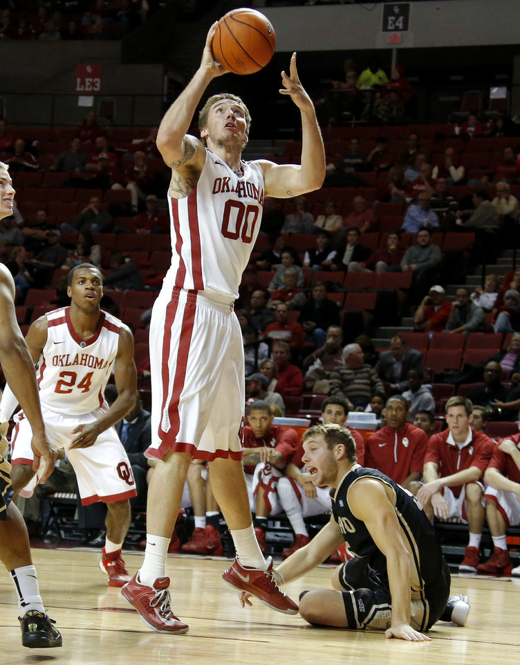 Photo - Oklahoma's Ryan Spangler puts up a shot as Idaho's Connor Hill (5) watches during a college basketball game between the University of Oklahoma Sooners and the Idaho Vandals at Lloyd Noble Center in Norman, Okla., on Wednesday, Nov. 13, 2013. Wednesday, Nov. 13, 2013. Photo by Bryan Terry, The Oklahoman