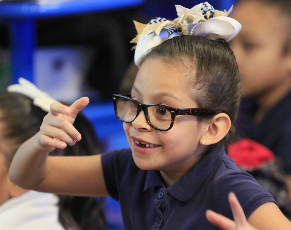 Photo -  Student Dayann Valles asks a question Tuesday in Tiffany Olvera's first-grade class at Heronville Elementary School. [Photo by Paul Hellstern, The Oklahoman]