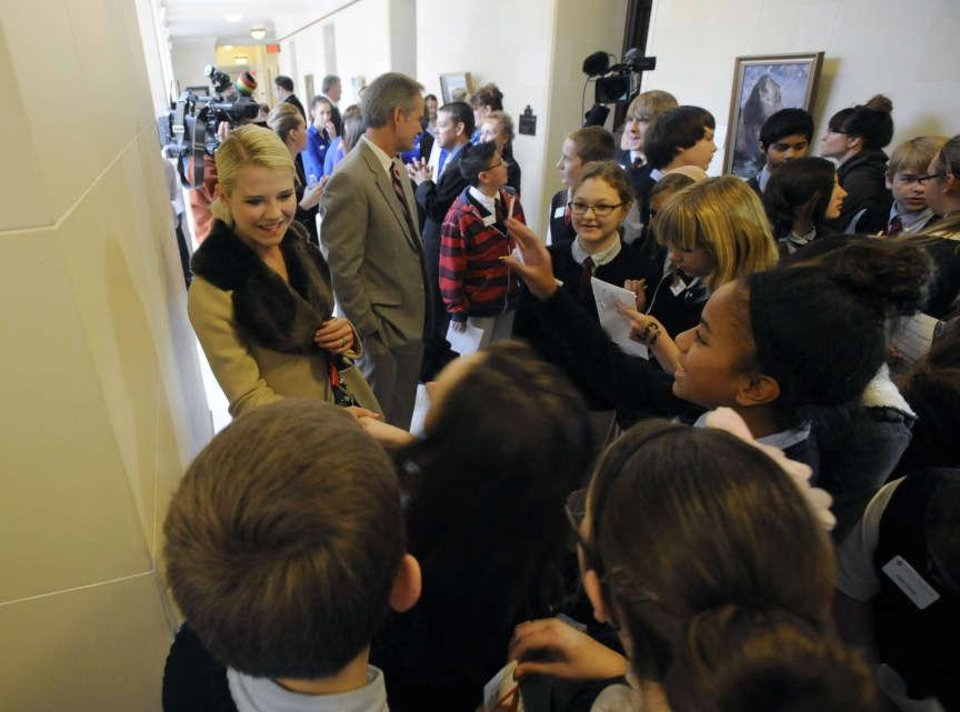 Photo -  Elizabeth Smart is greeted by students from American Preparatory Academy outside the house chambers at the Utah state Capitol on Thursday, Feb. 27, 2014. Since her 2002 abduction, nine-month captivity and 2003 rescue, Smart has become an advocate and speaker on behalf of abused and missing children and victims of sexual abuse. [AP file photo]
