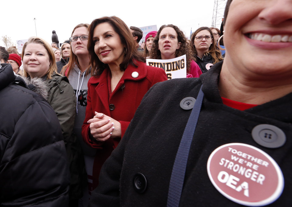 Photo - Joy Hofmeister State Superintendent of Public Instruction, stands in the crowd as Oklahoma teachers hold a rally at the State Capitol on Monday, April 2, 2018 in Oklahoma City, Okla.  Photo by Steve Sisney, The Oklahoman