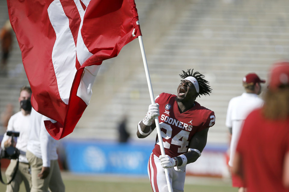 Photo - Oklahoma's Brian Asamoah (24) celebrates after the Sooners' 53-45 Red River Showdown win over Texas at the Cotton Bowl on Saturday. [Bryan Terry/The Oklahoman]
