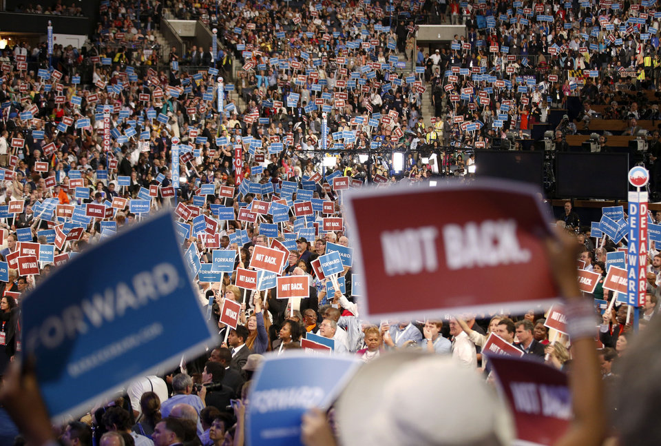 Photo - Delegates wave the signs during the Democratic National Convention in Charlotte, N.C., on Tuesday, Sept. 4, 2012. (AP Photo/Jae C. Hong)  ORG XMIT: DNC794