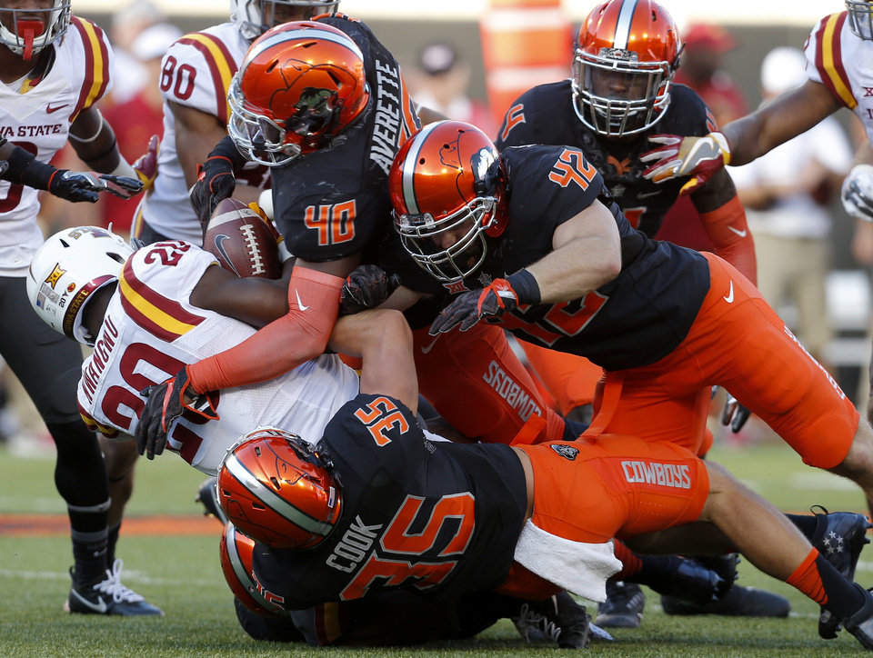 Photo - Oklahoma State's Chance Cook (35), Devante Averette (40) and Zach Smith (42) bring down Iowa State's Kene Nwangwu (20) in the fourth quarter during a college football game between the Oklahoma State University Cowboys (OSU) and the Iowa State University at Boone Pickens Stadium in Stillwater, Okla., Saturday, Oct. 8, 2016. Photo by Sarah Phipps, The Oklahoman