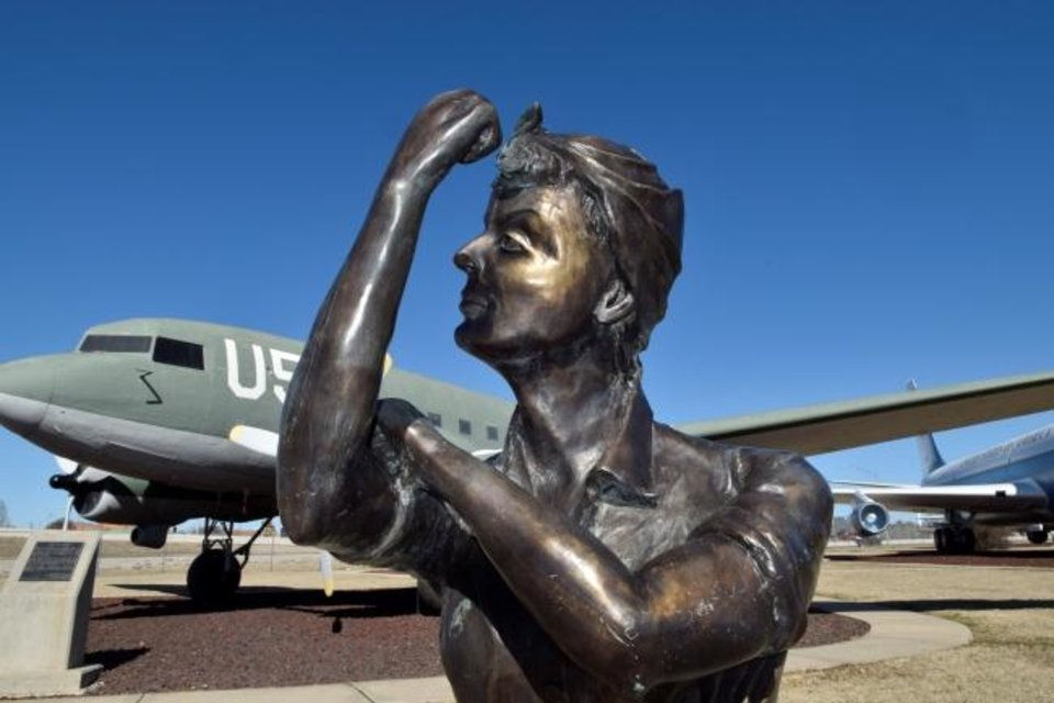 Photo -  'Rosie the Riveter' rolls up her sleeve in this bronze bust symbolizing the contributions to the war-effort made during and after World-War II by women at the Douglas Aircraft manufacturing plant in Oklahoma City and later at the Oklahoma City Air Logistics Complex at Tinker Air Force Base. One group on base that promotes diversity and inclusion represents federally employed women. [U.S. Air Force photo/Greg L. Davis]