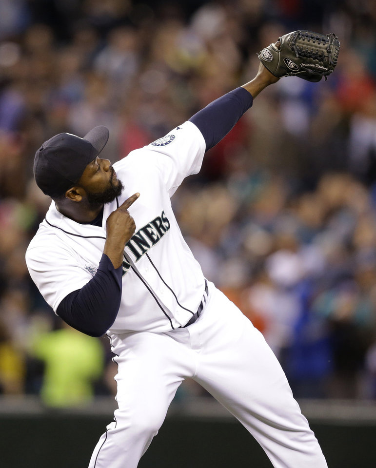 Photo - Seattle Mariners closer Fernando Rodney points skyward after the team beat the Kansas City Royals in a baseball game Saturday, May 10, 2014, in Seattle. The Mariners won 3-1. (AP Photo/Elaine Thompson)