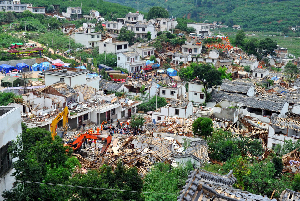 Photo - Collapsed houses are seen in Ludian County of Zhaotong City in southwest China's Yunnan Province, Monday, Aug. 4, 2014, following Sunday's strong earthquake.  Rescuers dug through shattered homes Monday looking for survivors of the strong earthquake in southern China's Yunnan province that killed hundreds and injured more than a thousand people. (AP Photo/Kyodo News) JAPAN OUT