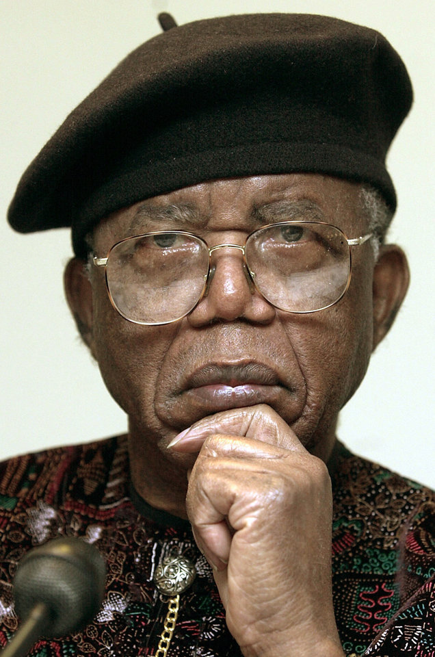 Photo - FILE - In this Oct. 12, 2002 file photo, Nigerian writer Chinua Achebe is shown in Frankfurt Main, Germany. Achebe, who wrote the classic,