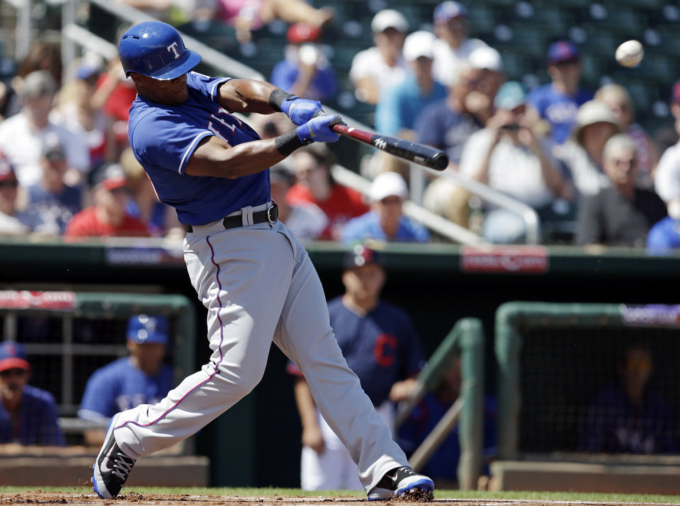 Photo - Texas Rangers' Adrian Beltre hits a two-run RBI single during the first inning of a spring exhibition baseball game against the Cleveland Indians, Tuesday, March 25, 2014, in Goodyear, Ariz. (AP Photo/Darron Cummings)