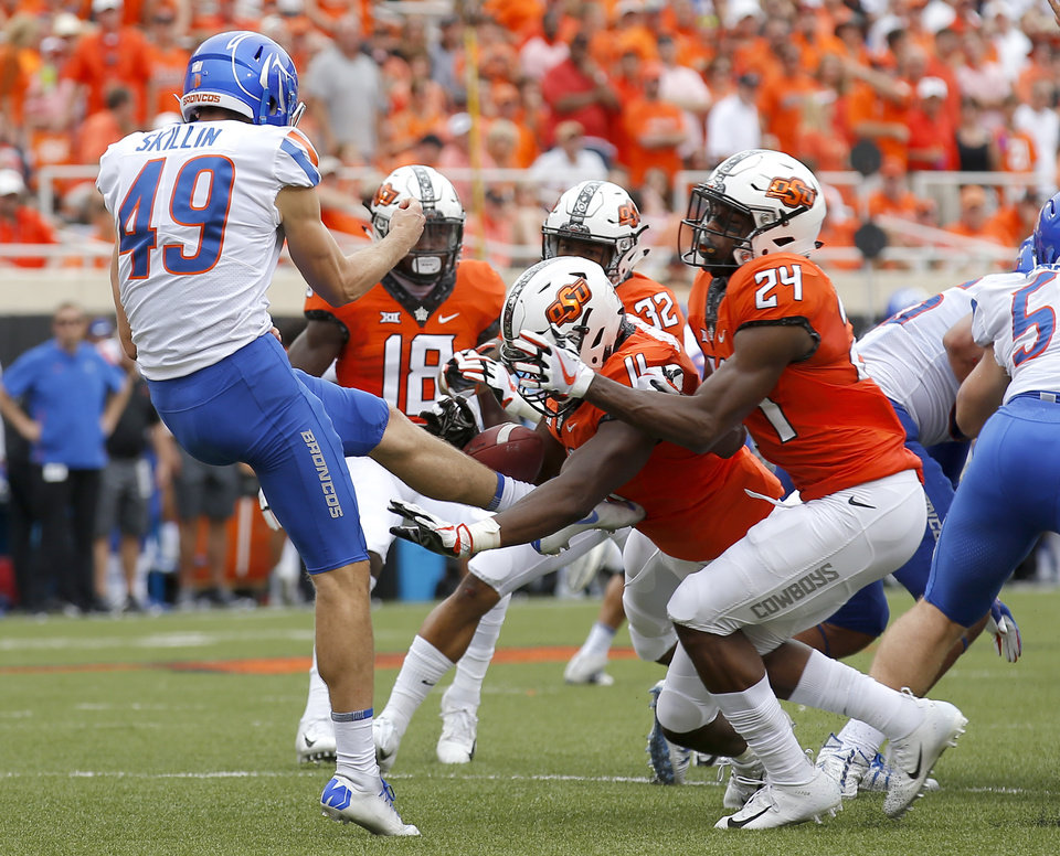 Photo - Oklahoma State's Amen Ogbongbemiga (11) blocks the punt of Boise State's Quinn Skillin (49) as Jarrick Bernard (24) helps in the second quarter  during a college football game between the Oklahoma State Cowboys (OSU) and the Boise State Broncos at Boone Pickens Stadium in Stillwater, Okla., Saturday, Sept. 15, 2018. Photo by Sarah Phipps, The Oklahoman