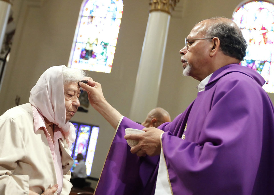 Felicitas Garcia, left, receives ashes on her forehead from Fr. Gabriel Coelho during an Ash Wednesday mass at the Corpus Christi Cathedral, Wednesday, Feb. 22, 2012 in Corpus Christi, Texas. (AP Photo/Corpus Christi Caller-Times, Rachel Denny Clow)  MANDATORY CREDIT