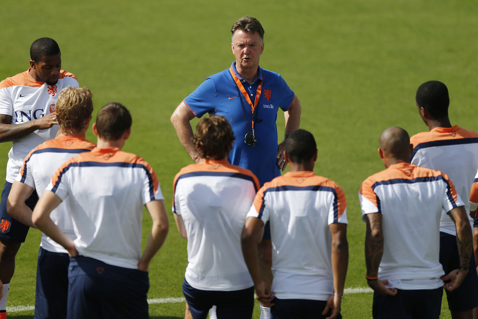 Photo - Coach Louis van Gaal of the Netherlands briefs his team during a training session in Rio de Janeiro, Brazil, Thursday, June 26, 2014.  Netherlands will play Group A runner-up Mexico in the second round on Sunday in Fortaleza. (AP Photo/Wong Maye-E)