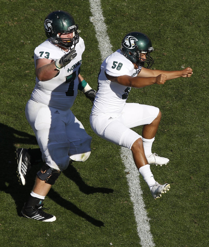 Photo -   Sacramento State place kicker Edgar Castaneda, right, celebrates making the winning field goal with Tyler Worthley against Colorado in the fourth quarter of their NCAA college football game in Boulder, Colo., Saturday, Sept. 8, 2012. Sacramento State won 30-28. (AP Photo/David Zalubowski)