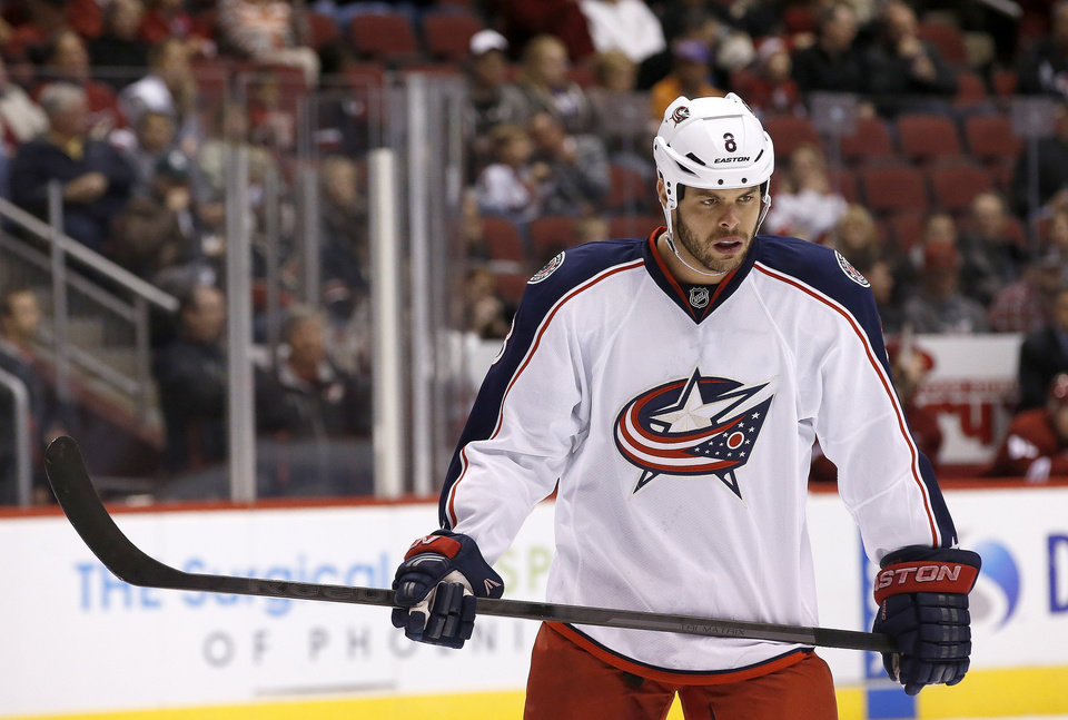 Photo - FILE - In this Jan. 2, 2014 file photo, Columbus Blue Jackets' Nathan Horton, plays in his first NHL hockey game of the season against the Phoenix Coyotes in Glendale, Ariz. Horton, a prime free-agent signing who missed the first half of the season after shoulder surgery, has led the surging Blue Jackets to a 4-1-0 record so far in 2014. (AP Photo/Ross D. Franklin, File)