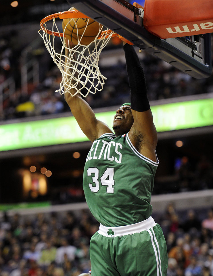 Boston Celtics forward Paul Pierce (34) dunks against the Washington Wizards during the first half of an NBA basketball game on Saturday, Nov. 3, 2012, in Washington. (AP Photo/Nick Wass)