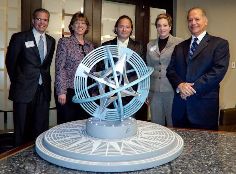 "Photo - Artist Owen Morrel, center, is pictured with a model of his winning design for a sculpture titled ""Compass Rose."" With him, from left, are Stuart Graham, Leadership Oklahoma City anniversary project chairman; Nancy Hodgkinson of the Inasmuch Foundation, Cathy O'Connor of the city of Oklahoma City, and Michael Joseph, art design selection chairman.  ORG XMIT: 1004061550375065"