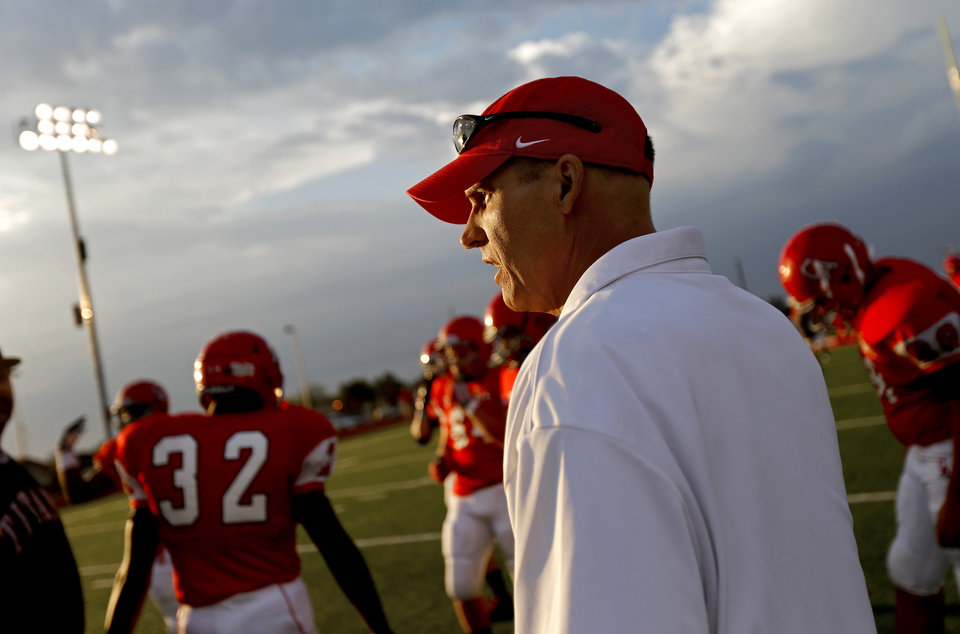 Assistant coach Mike Corley walks the field before the high school football game between Carl Albert and Coweta in Midwest City, Friday, September 7, 2012.