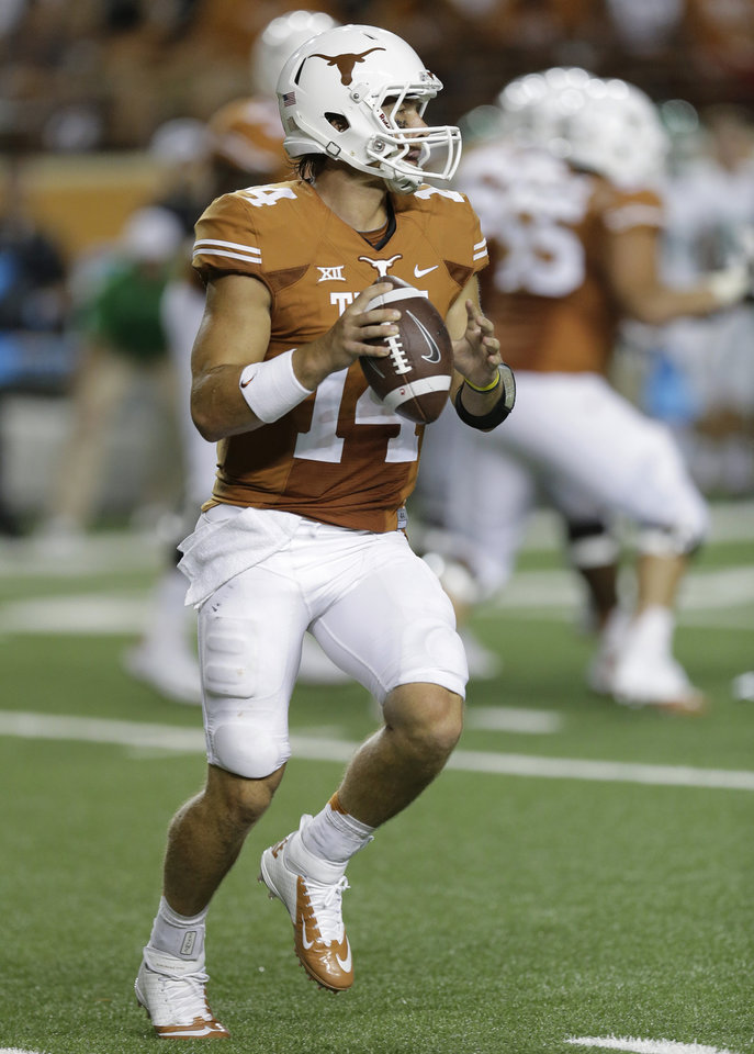 Texas\' David Ash (14) looks to throw against North Texas during the second half of an NCAA college football game, Saturday, Aug. 30, 2014, in Austin, Texas. Eric Gay - ASSOCIATED PRESS