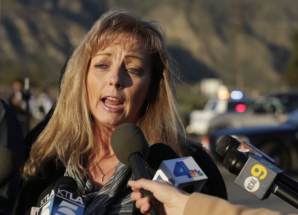 Cindy Bachman, Public Information officer for the San Bernardino County Sheriff's Department talks about the hunt for accused killer and fired Los Angeles police officer, Christopher Dorner in Yacaipa, Calif.,Tuesday, Feb. 12, 2013. (AP Photo/Chris Carlson)
