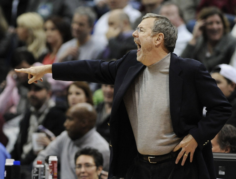 Photo - Brooklyn Nets interim head coach P.J. Carlesimo shouts to his team in the second half of an NBA basketball game against the Minnesota Timberwolves, Wednesday, Jan. 23, 2013, in Minneapolis. The Nets won 91-83. (AP Photo/Jim Mone)