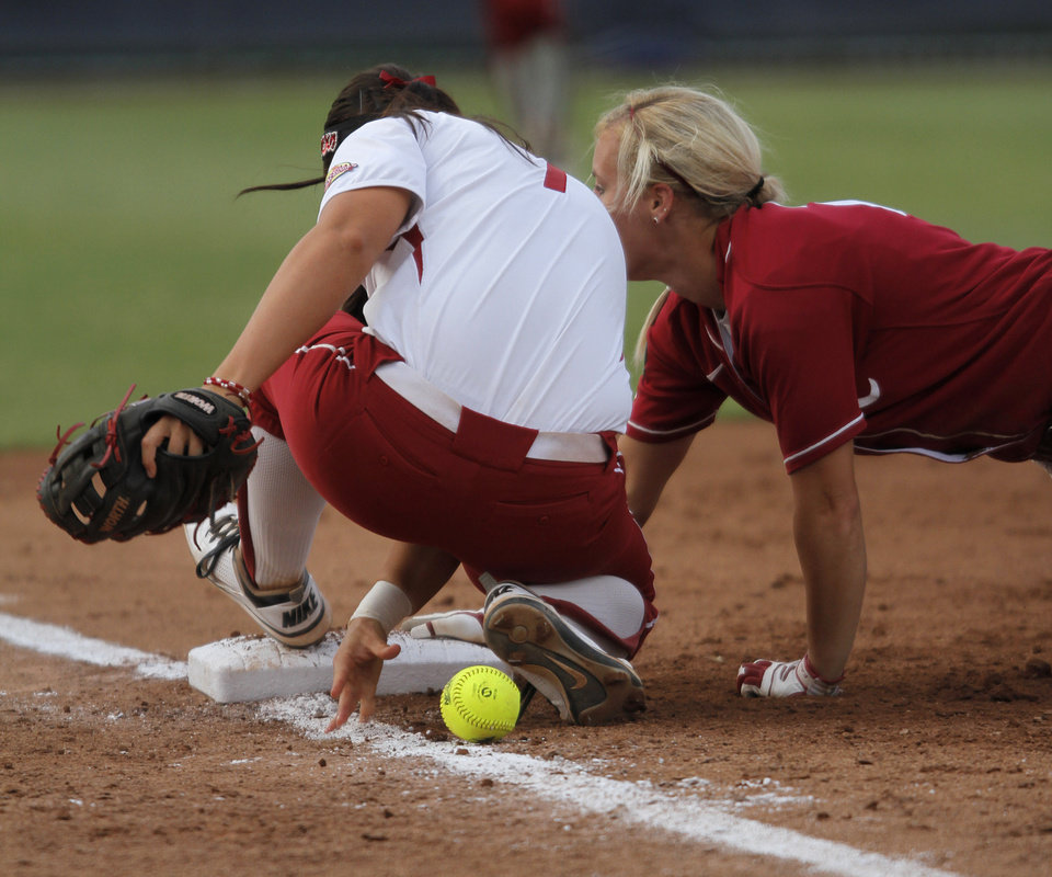 Photo - Alabama's Jazlyn Lunceford (2) slides into third base past Oklahoma's Javen Henson (7) during a Women's College World Series softball game between OU and Alabama at ASA Hall of Fame Stadium in Oklahoma City, Tuesday, June 5, 2012.  Photo by Garett Fisbeck, The Oklahoman