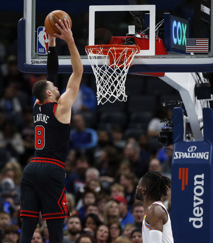 Photo - Chicago's Zach LaVine (8) dunks the ball next to Oklahoma City's Nerlens Noel (9) during an NBA basketball game between the Oklahoma City Thunder and Chicago Bulls at Chesapeake Energy Arena in Oklahoma City, Monday, Dec. 16, 2019. [Nate Billings/The Oklahoman]