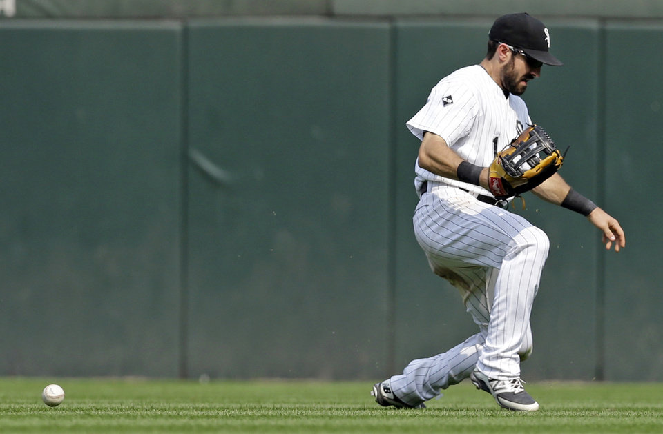 Photo - Chicago White Sox center fielder Adam Eaton is unable to make the catch on a single hit by Houston Astros' Marwin Gonzalez during the seventh inning of a baseball game in Chicago on Sunday, July 20, 2014. (AP Photo/Nam Y. Huh)