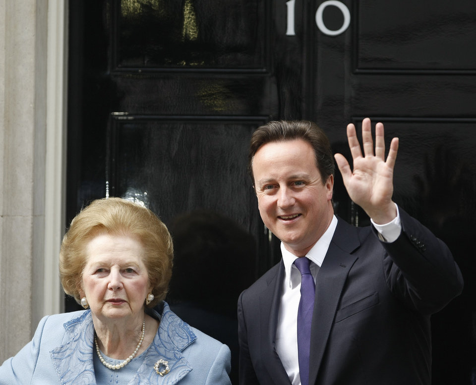 Photo - FILE - This is a Tuesday, June, 8, 2010 file photo of  Britian's Prime Minister David Cameron poses with former Prime Minister Margaret Thatcher on the doorstep of 10 Downing Street  in London.  Ex-spokesman Tim Bell says that Thatcher has died. She was 87. Bell said the woman known to friends and foes as