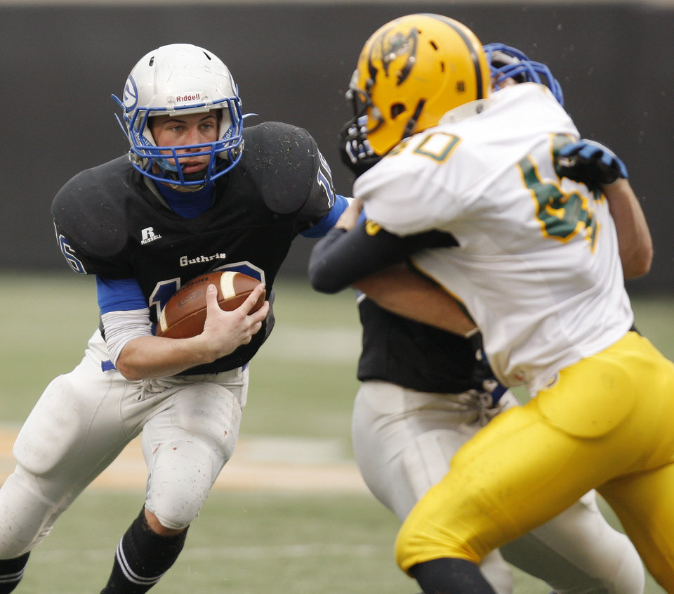 Photo - Guthrie quarterback Bryan Dutton (16) carries the ball during the Class 5A high school football state championship game between Guthrie and Lawton MacArthur at Boone Pickens Stadium in Stillwater, Okla., Friday, Dec. 2, 2011. Photo by Nate Billings, The Oklahoman