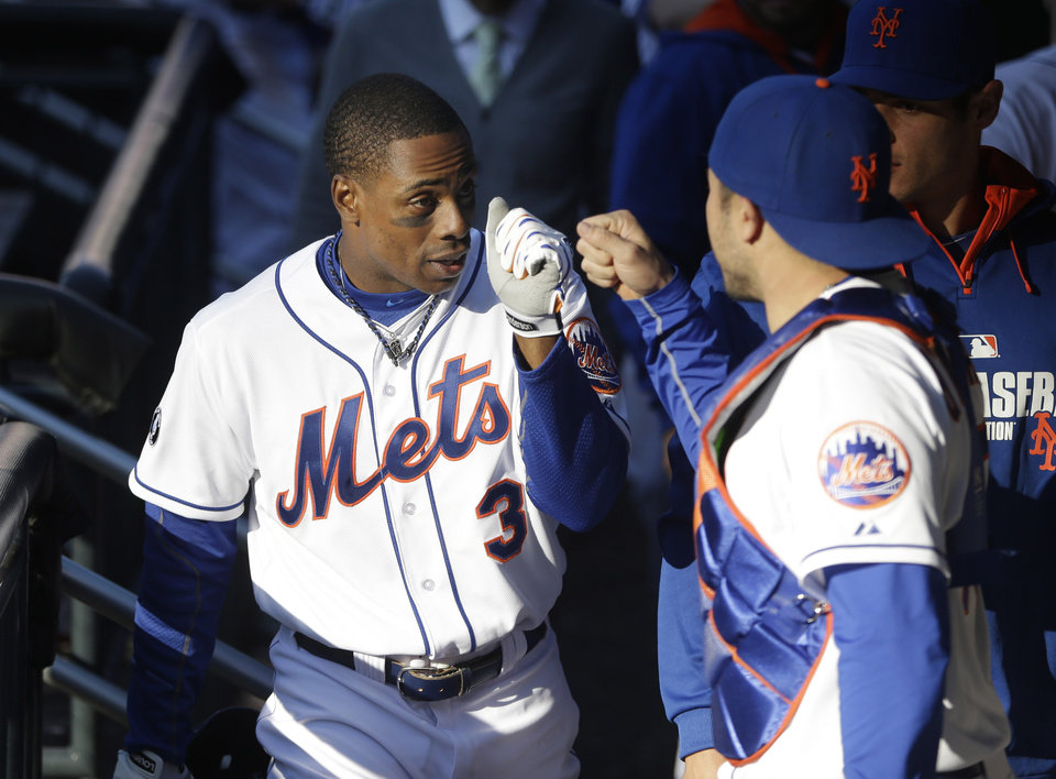 Photo - New York Mets' Curtis Granderson celebrates with teammates in the dugout after hitting a walk-off sacrifice fly during the fourteenth inning of the baseball game against the Atlanta Braves at Citi Field, Sunday, April 20, 2014 in New York. The Mets defeated the Braves in extra innings 4-3. (AP Photo/Seth Wenig)